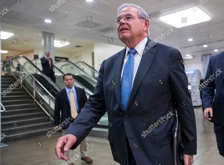 Senator Bob Menendez, D-N.J., arrives on Capitol Hill Washington, for a closed-door meeting with Secretary of State Rex Tillerson and Defense Secretary James Mattis. Menendez, charged with using his political influence to help a wealthy campaign donor, is trying to benefit from a U.S. Supreme Court decision reversing a jury verdict against former Virginia Republican Gov. Bob McDonnell. With varying success, ex-politicians from ex-New York Assembly Speaker Sheldon Silver to one-time Chicago Mayor Rod Blagojevich have tried to use the high court's ruling in McDonnell to at worst win a new trial and at best force an end to their prosecutions