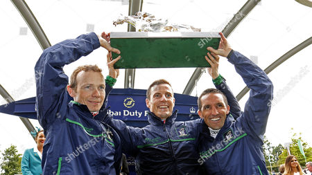 Great Britain & Ireland team of JAMIE SPENCER (left) FRAN BERRY (centre) and NEIL CALLAN (right) lift The Dubai Duty Free Shergar Cup Classic Ascot