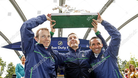 Stock Picture of reat Britain & Ireland team of JAMIE SPENCER (left) FRAN BERRY (centre) and NEIL CALLAN (right) lift The Dubai Duty Free Shergar Cup Classic Ascot