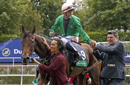GREAT HALL (Fran Berry) with trainer Mick Quinn after The Dubai Duty Free Shergar Cup Challenge Ascot