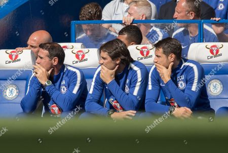Left to right Chelsea Assistant coaches Angelo Alessio ,Paolo Vanoli  and Carlo Cudicini   with a worried appearance.