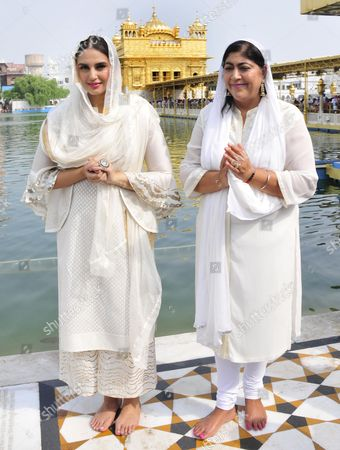 Bollywood actor Huma Qureshi (L) and British Director Gurinder Chadha pose for photographs as they visit the Golden Temple, the holiest of Sikh shrines in Amritsar, India, 12 August 2017. Huma Qureshi and British Director Gurinder Chadha are in Amritsar to promote their upcoming movie, Partition: 1947. Directed by Gurinder Chadha, the movie is scheduled to release all over India in Hindi as 'Partition: 1947' and in English as 'Viceroy's House', 18 August 2017. The movie is based on the story of the partition of India in the year 1947.