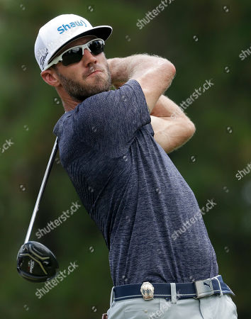 Graham Delaet watches his tee shot on the third hole during the third round of the PGA Championship golf tournament at the Quail Hollow Club, in Charlotte, N.C