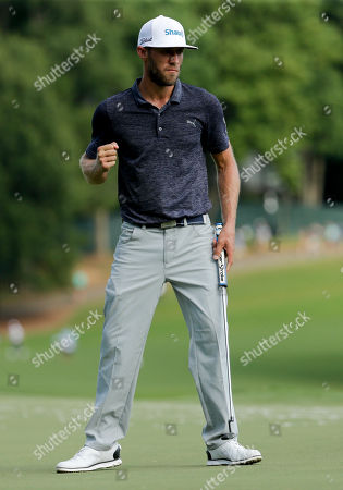 Graham Delaet celebrates after making a putt on the 15th hole during the third round of the PGA Championship golf tournament at the Quail Hollow Club, in Charlotte, N.C
