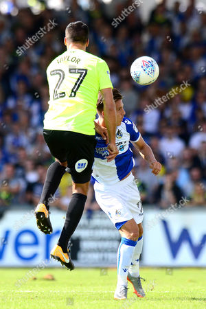 Tom Nichols of Bristol Rovers challenges for a header with Steven Taylor of Peterborough United