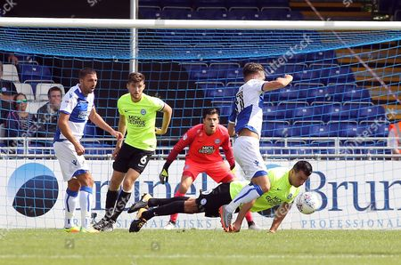 Steven Taylor of Peterborough United attempts to block Tom Nichols of Bristol Rovers with his head