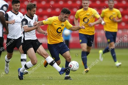 Torquay United player Jake Gosling is tackled during the English National League game between Gateshead and Torquay United at Gateshead International Stadium on Aug 12