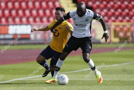 Torquay United player Jake Gosling is blocked off by Gateshead player Jamal Fyfield during the English National League game between Gateshead and Torquay United at Gateshead International Stadium on Aug 12