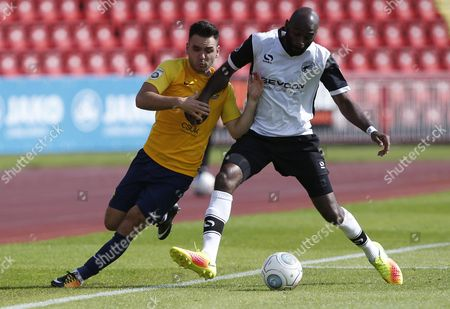 Torquay United player Jake Gosling battles with Gateshead player Jamal Fyfield during the English National League game between Gateshead and Torquay United at Gateshead International Stadium on Aug 12