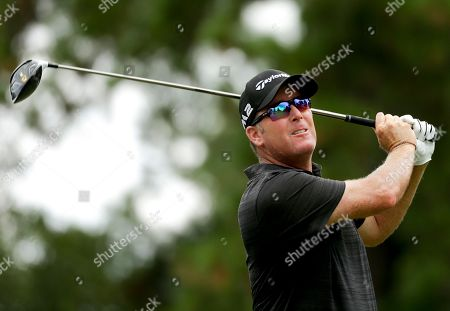 D. A. Points watches his tee shot on the third hole during the third round of the PGA Championship golf tournament at the Quail Hollow Club, in Charlotte, N.C