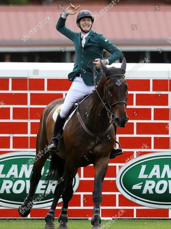 Stock Image of Ireland's Daniel Coyle on Cavalier Rusticana celebrates after clearing the wall to finish as joint winners