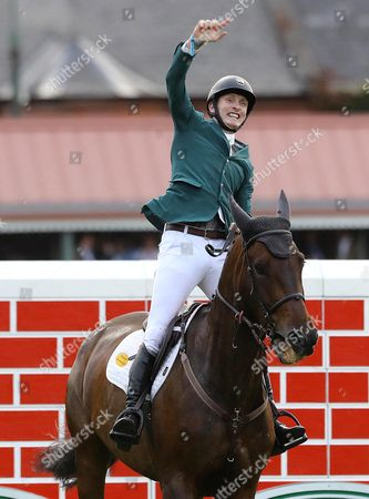 Ireland's Daniel Coyle on Cavalier Rusticana celebrates after clearing the wall to finish as joint winners