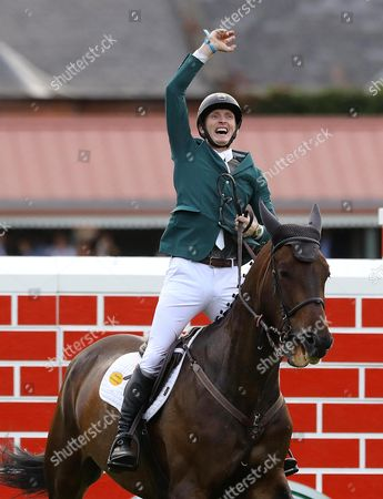 Stock Picture of Ireland's Daniel Coyle on Cavalier Rusticana celebrates after clearing the wall to finish as joint winners
