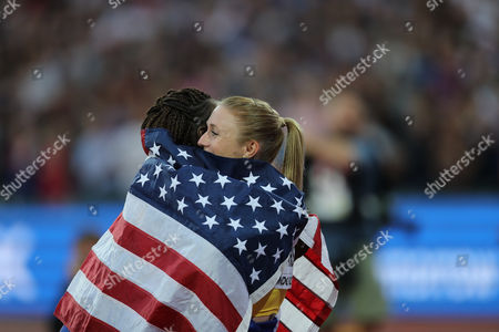 Stock Photo of Sally Pearson congratulated by Dawn Harper-Nelson after 100m hurdle win the IAAF World Championships 120817 at the London Stadium, London