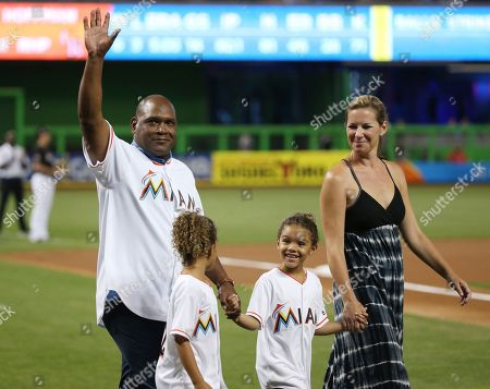 Tim Raines, Shannon Raines, Ava Raines, Amelie Raines Hall of Famer Tim Raines waves as he walks with his wife, Shannon, and 6-year-old twins, Amelie, left, and Ava, as he is introduced before a baseball game between the Miami Marlins and the Colorado Rockies, in Miami. Raines was honored by the Marlins for being inducted into the Hall of Fame last month