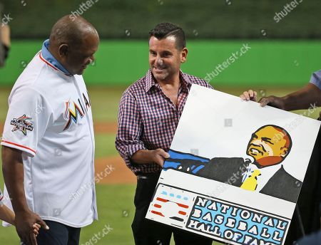 Tim Raines, David Samson Hall of Famer Tim Raines, left, is presented with a painting by Miami Marlins president David Samson before a baseball game between the Marlins and the Colorado Rockies, in Miami. Raines was honored by the Marlins for being inducted into the Hall of Fame last month
