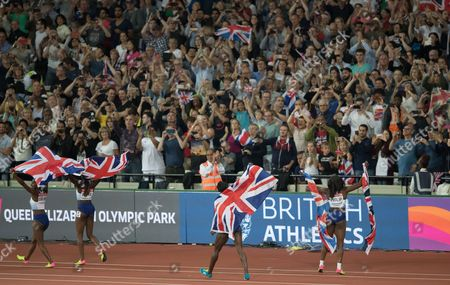 British quartet of Asha Philip, Desiree Henry, Dina Asher-Smith and Daryll Neita  celebrate  silver in the women's 4x100m relay with the Capacity crowd at the London Stadium