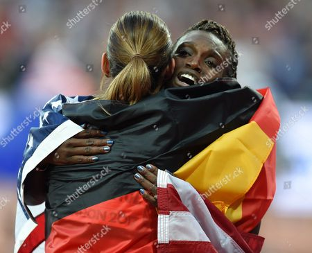 Bronze medal winner Pamela Dutkiewicz of Germany, and silver medal winner Dr Dawn Harper Nelsonof USA, celebrating after the100 meter hurdles final in London at the 2017 IAAF World Championships athletics.