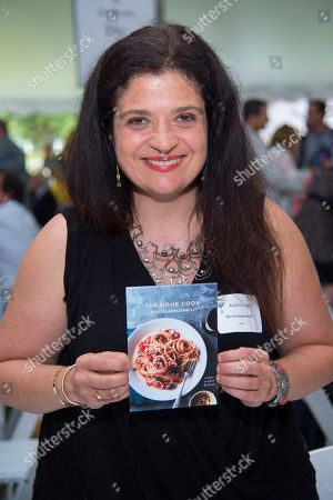 Stock Photo of Alex Guarnaschelli attends the East Hampton Library's 13th Annual Authors Night Benefit, in East Hampton, NY
