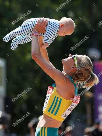 Australia's Claire Tallent holds her 12-weeks-old son Harvey after finishing the women's 20-kilometer race walk during the World Athletics Championships in London