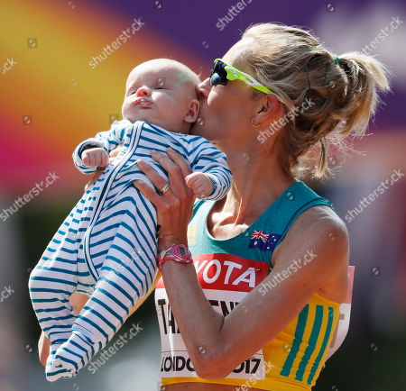 Australia's Claire Tallent kisses her 12-weeks-old son Harvey after finishing the women's 20-kilometer race walk during the World Athletics Championships in London