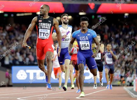 Trinidad and Tobago's Lalonde Gordon, left, races anchor leg to win the gold medal in the final of the Men's 4x400m relay during the World Athletics Championships in London . At right is United States' Fred Kerley, silver, and at center Britain's Martyn Rooney, bronze