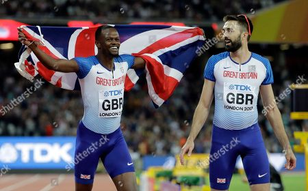 Britain's Rabah Yusif and Martyn Rooney, right, react after they took the bronze medal in the men's 4x400-meter final during the World Athletics Championships in London
