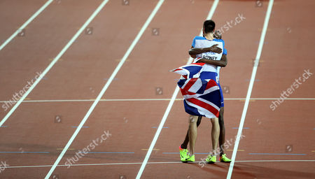 Rabah Yousif and Martyn Rooney of Great Britain celebrates with a Bronze after the Men's 4x400 meters relay final