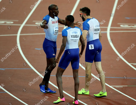 Matthew Hudson-Smith, Rabah Yousif and Martyn Rooney of Great Britain celebrates with a Bronze after the Men's 4x400 meters relay final