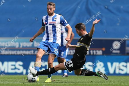 Nick Powell of Wigan Athletic and Alex Bruce of Bury
