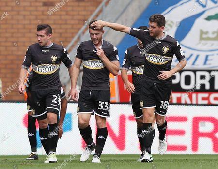 Alex Bruce of Bury celebrates scoring the equalising goal to make it 1-1