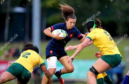 France vs Australia . France's Caroline Drouin with Cheyenne Campbell and Millie Boyle of Australia