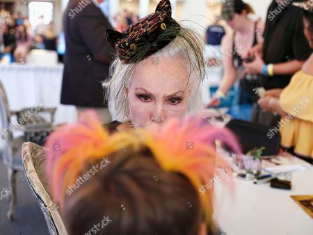 Actress and former Cat Woman Julie Newmar talks with fan Joey Bartlett, 9, from Gig Harbor, Wa. at CatCon 2017 in Pasadena, Calif