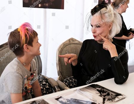 Actress and former Cat Woman Julie Newmar jokes around with fan Joey Bartlett, 9, from Gig Harbor, Wa. at CatCon 2017 in Pasadena, Calif