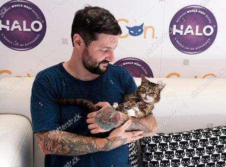 Julie Newmar Lil Bub and Mike Bridavsky wait to meet and greet fans during CatCon 2017 in Pasadena, Calif