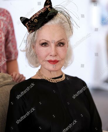 Actress and former Cat Woman, Julie Newmar waits to sign autographs at CatCon 2017 in Pasadena, Calif