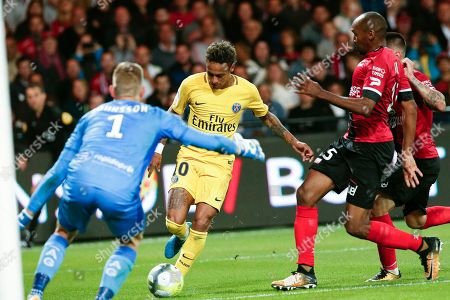 PSG's Neymar, center, tries to score past Guingamp goalkeeper Karl-Johan Johnsson, left, during the French League One soccer match between Guingamp and PSG at the Roudourou stadium in Guingamp, western France, . Neymar makes his long-awaited debut with Paris Saint-Germain on Sunday in the small Brittany town of Guingamp