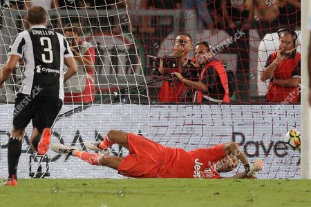 Stock Picture of Juventus goalkeeper Gigi Buffon fails to save a penalty kick scored by Lazio's Ciro Immobile during the Italian Super Cup final match between Lazio and Juventus at Rome's Olympic stadium