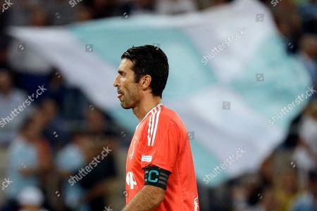 Stock Photo of Juventus goalkeeper Gigi Buffon walks on the pitch after Lazio's Ciro Immobile scored the second goal during the Italian Super Cup final match between Lazio and Juventus at Rome's Olympic stadium