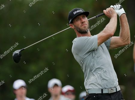 Stock Photo of Graham DeLaet watches his tee shot on the third hole during the final round of the PGA Championship golf tournament at the Quail Hollow Club, in Charlotte, N.C