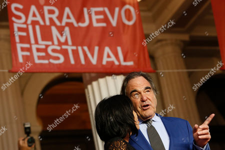 Bosnia Oliver Stone American screenwriter, film director, and producer Oliver Stone and his wife Sun-jung Jung walking on red carpet to receive Sarajevo Film Festival's top honour award, the Heart of Sarajevo Award, in Sarajevo, Bosnia, on