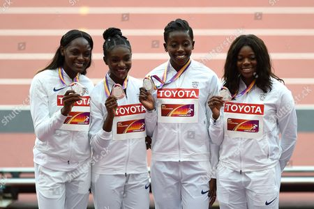 Daryll Neita, Dina Asher-Smith, Desiree Henry and Asha Philip of Great Britain pose with their silver medals