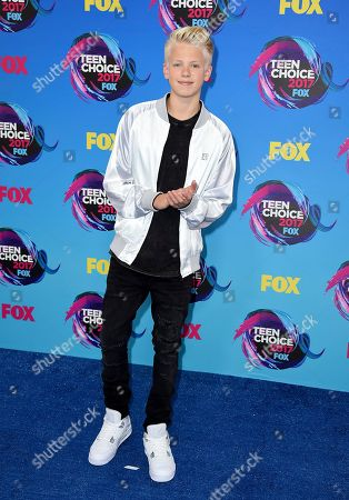 Carson Lueders arrives at the Teen Choice Awards at the Galen Center, in Los Angeles