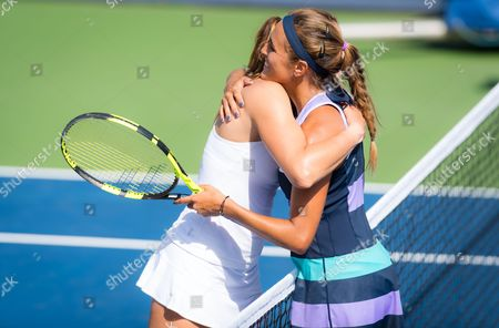 Mariana Duque-Marino of Colombia & Monica Puig of Puerto Rico hug at the net after their second qualification round match at the 2017 Western & Southern Open WTA Premier 5 tennis tournament