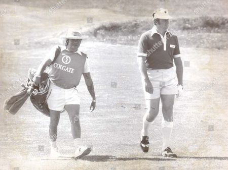 Pga Champion Brian Barnes And His Cadde Jim Sullivan In Their Shorts In Southport.