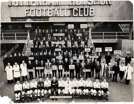Tottenham Hotspur Football Club Team And Staff Line Up 1961. (front Row L-r) First Team : Dave Mackay John White Bobby Smith Bill Brown Peter Baker W. Nicholson (manager) Danny Blanchflower C. Poynton (trainer) Maurice Norman Les Allen Ron Henry Terry Dyson Cliff Jones. (second Row L-r) Trainers : J. Wallis A. Thompson J. Coxford Doctor : A. E. Tughan Groundsmen : H. Naylor D. Coulston Maintenance Foreman : E. Watson Chief Scout : N. Liddel Assistant Secretary : A. Leather Secretary : R. Jarvis Assistant Manager : H. Evans Office Staff : H. Mansfield Mrs B. Wallace W. Beeby W. Graves A. H. Joyce Office Maintenance : Mrs Naylor Mrs Turner Catering : E. Phillips Mrs Z. Dobson D. Dixon. (third Row L-r) Reserves : J. Hollowbread J. Hills J. Ryden F. Saul F. Clayton B. Aitcheson M. Hopkins K. Barton T. Medwin T. Marchi Directors : S. Wale Fred J. Bearman (chairman) F. John Bearman D. Deacock First Aid : L. Davis Chief Steward : J. Rist Steward : G. Anderson Commissionaire : A. W. Ferguson Turnstile Operator : J. Dearman Programme Seller : J. Aylward Programme Distributor : S. Hughes Band : L. Hatch (fourth Row L-r) Reserves : R. Piper J. Fleming R. Moss A. Reed B. Fittock F. Smith A. Wilkie J. Collins J. Smith F. Sharne W. Dodge N. Lee A. Smith C. Brown D. Tharme. (fifth Row L-r) Juniors : B. Roffman T. Lloyd P. Beal R. Smith S. Tickridge (coach) B. Embry D. Sunshine R. Lowe B. Lumley A. Davis. (back Row L-r) Maintenance Staff : B. Barnes F. Chapman F. Gold M. Stockwell W. Fox F. Murray T. Heathfield G. Dorling M. Moeser V. Knott Gateman : W. Elmore Ground Pass Official : F. Parrett.