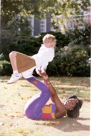 Editorial picture of Tessa Sanderson With Zoe Hall Balanced On Her Feet ...athlete.