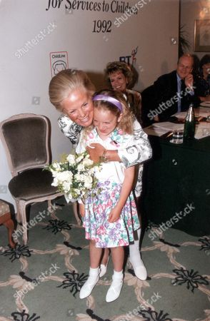 Katharine Duchess Of Kent Cuddles A Child At Childline Function. Esther Rantzen Can Be Seen In The Background.
