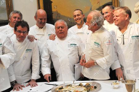Judges Brian Turner, David Nicholl, Albert Roux, Michel Roux Junior, Michel Roux Senior, Gary Rhodes, Richard Vines and Alain Roux stand around the winning dish