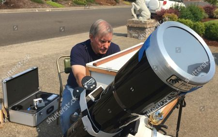 Amateur astronomer Mike Conley practices with the telescope he will use to document the Aug. 21 total solar eclipse, at his home in Salem, Ore. Conley is part of a project led by the National Solar Observatory to have dozens of citizen-scientists posted across the U.S. photograph the celestial event in an effort to create a live movie of its path that will help scientists learn more about the sun's corona